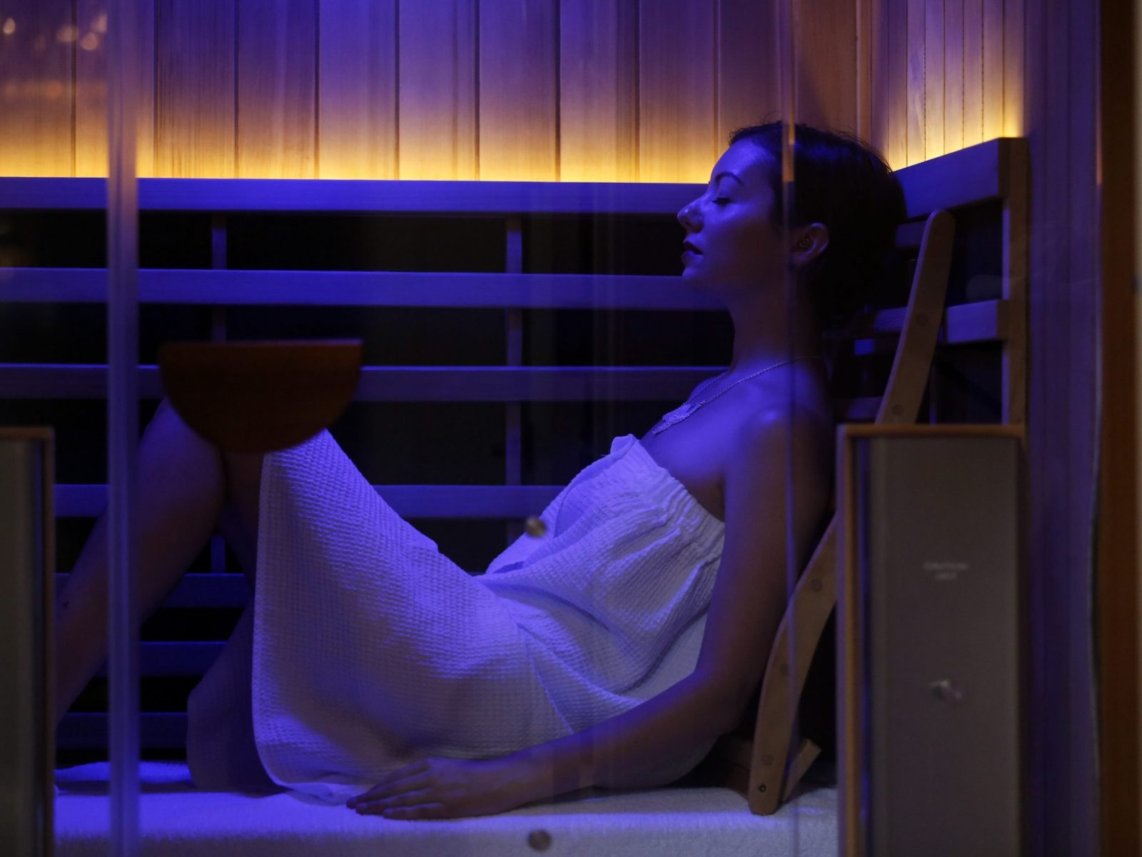 Sarah Buonocore of Granby uses the infrared sauna, which is said to assist with detoxification, relaxation, burning calories, pain relief, anti-aging, skin purification, cell health and improved circulation, at Thelo Home and Modern Wellness June 13, 2018 in Northampton.